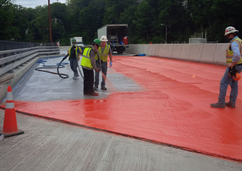 Spray application of water proofing membrane to new bridge deck