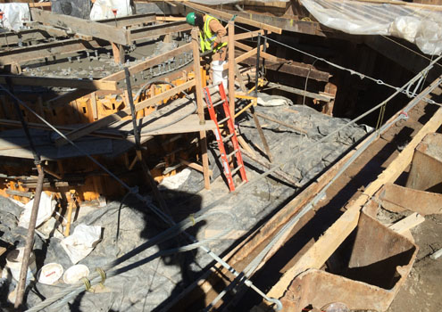 Insulating blankets used to maintain temperature for Pier 3 footing cure